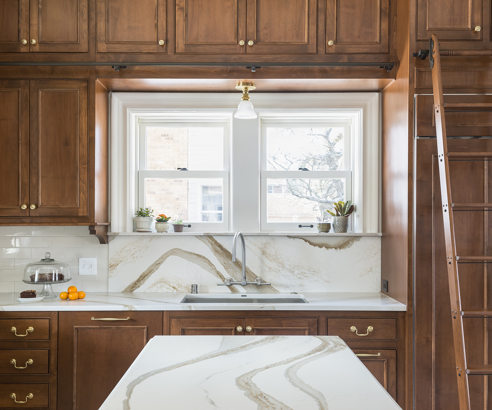 Continuing the countertop material on the backsplash creates a stunning focal point in the kitchen and adds continuity.