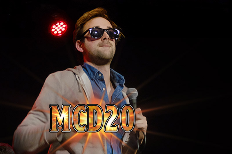 #MCD20 - MCD20 is a mystery. Nobody knows his true identity. He is only a rumour, wrapped up in a mystery, covered in a perplexing sauce. Whoever he is, he's the warm up guy for Questing Time, who typically gets the crowd going with a very accessible 'Beastie Boys' inspired rap bit. One day we might find out more about this mysterious, unmasked stranger. But not today.