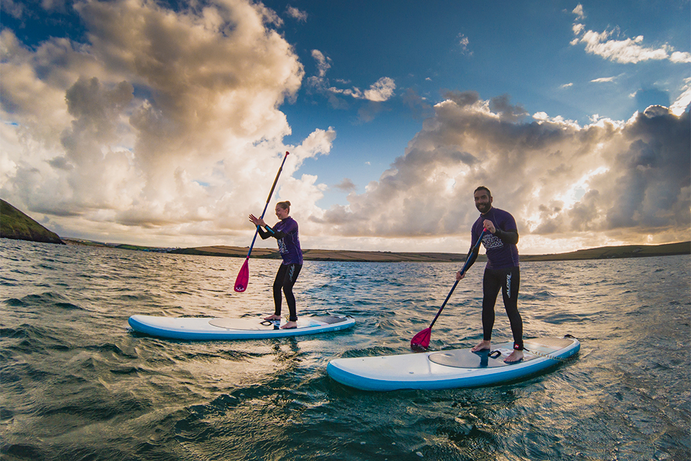 SUP sessions - Stand-up paddle-boarding is a super-accessible sport that gets you out on the ocean in no time, building your core strength and fitness, and whilst it's easy to learn it offers adventures to last a lifetime. The surf school on Polzeath beach is one of the first in the UK to teach SUP-ing, so whether it's relaxation or exhilaration you're seeking, let us get your SUP adventure started here.