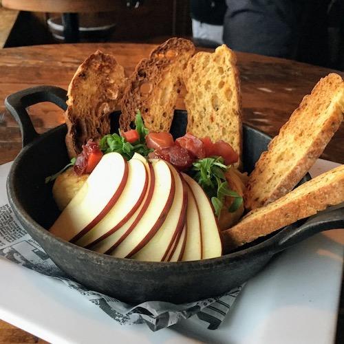 BRIE EN CRUTE – Soft cow's milk cheese, puff pastry shell, apple chutney, arugula, crostini