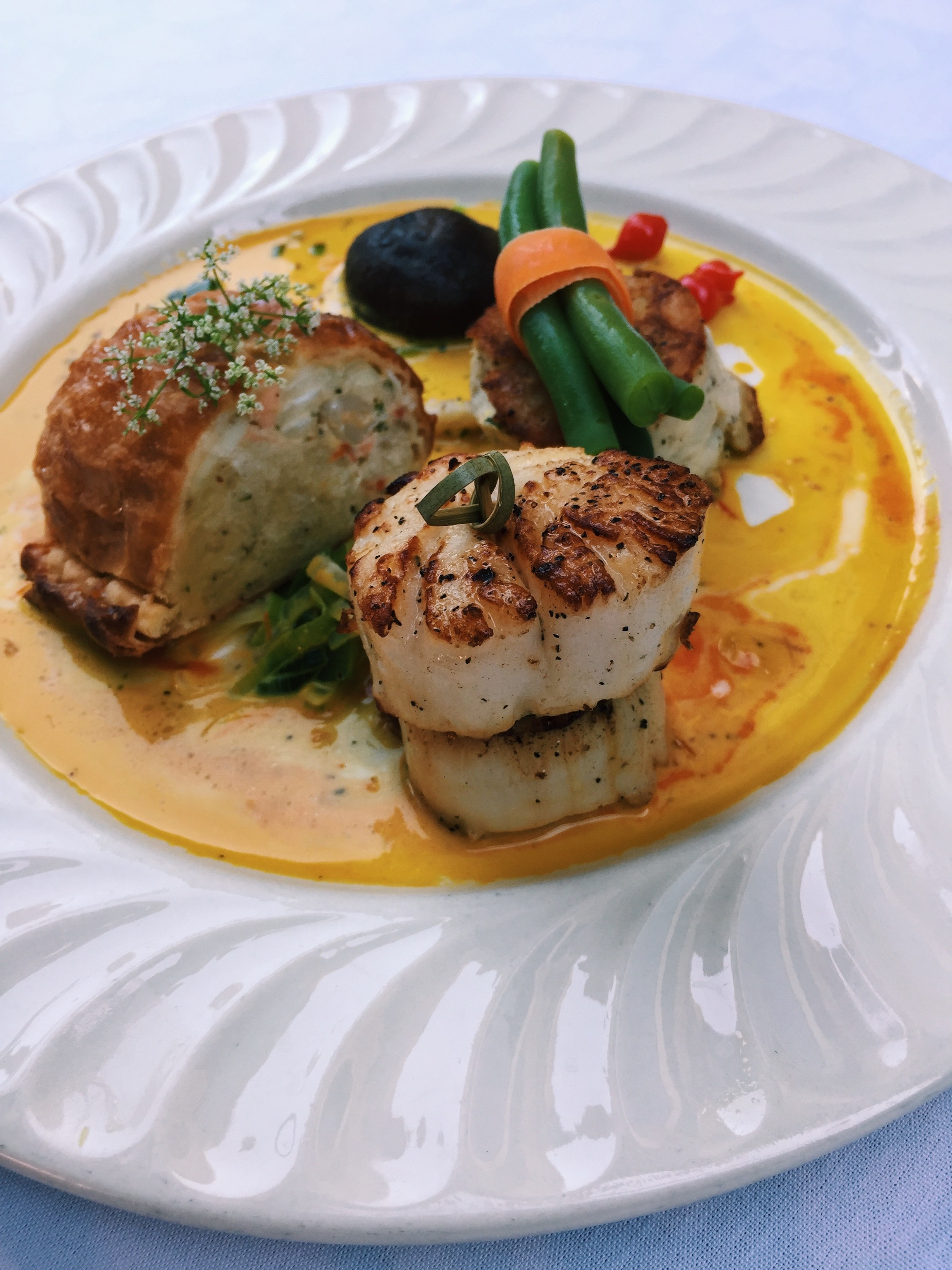 Duet of Pan Seared Scallop and Seafood Strudel