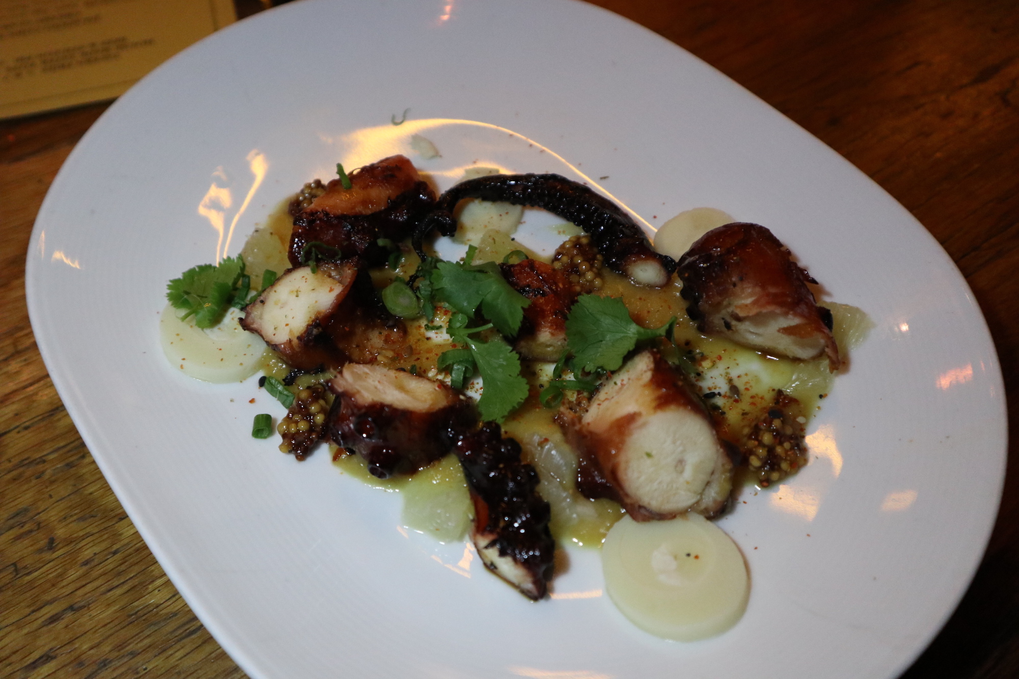 Teriyaki Octopus with Roasted Sesame Pineapple Puree, Spicy Whole Seed Mustard, Lime, Hearts Of Palm- shareable