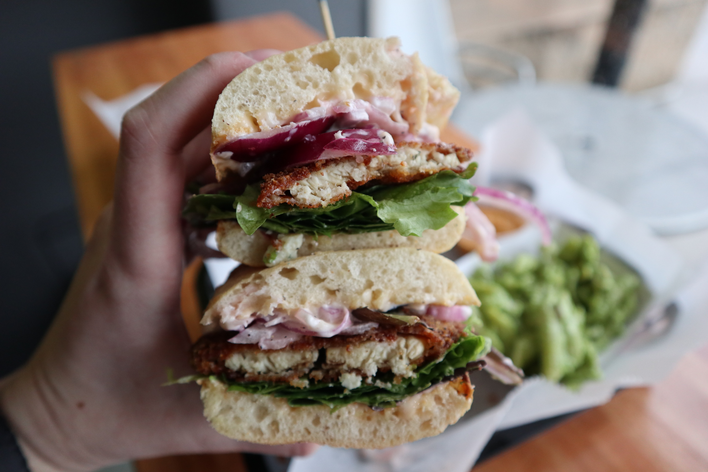 #11 Criollo Fish Sandwich: Fried tilapia, pickled red onions, fresh jalapenos, mixed green lettuce, and rocoto mayo  Side of pasta salad with cilantro cream