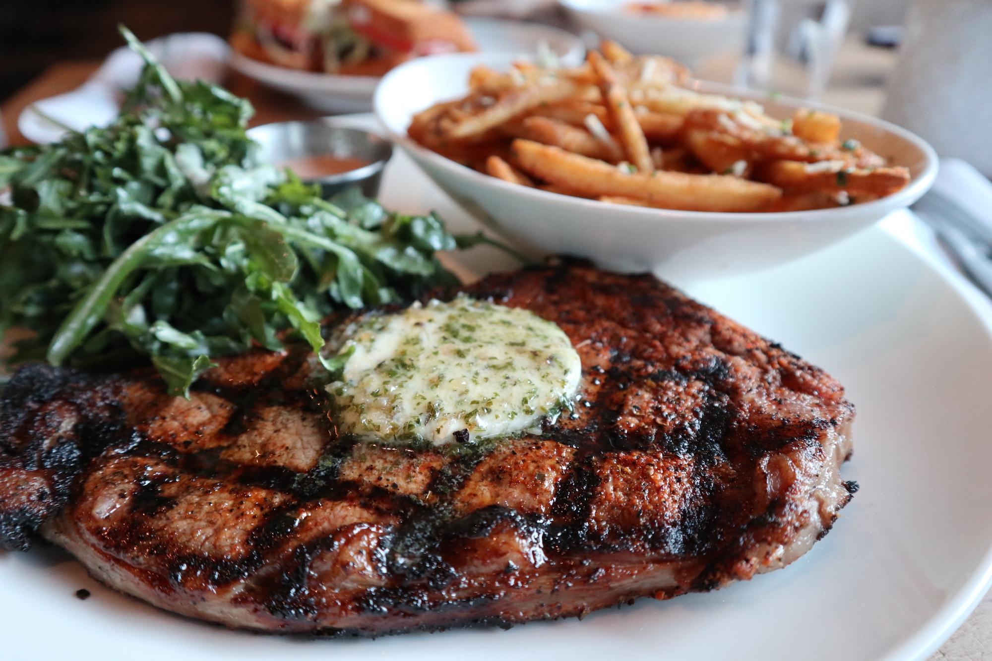 Steak Frites: Kansas City stirp, bearnaise butter, arugula salad, truffle fries