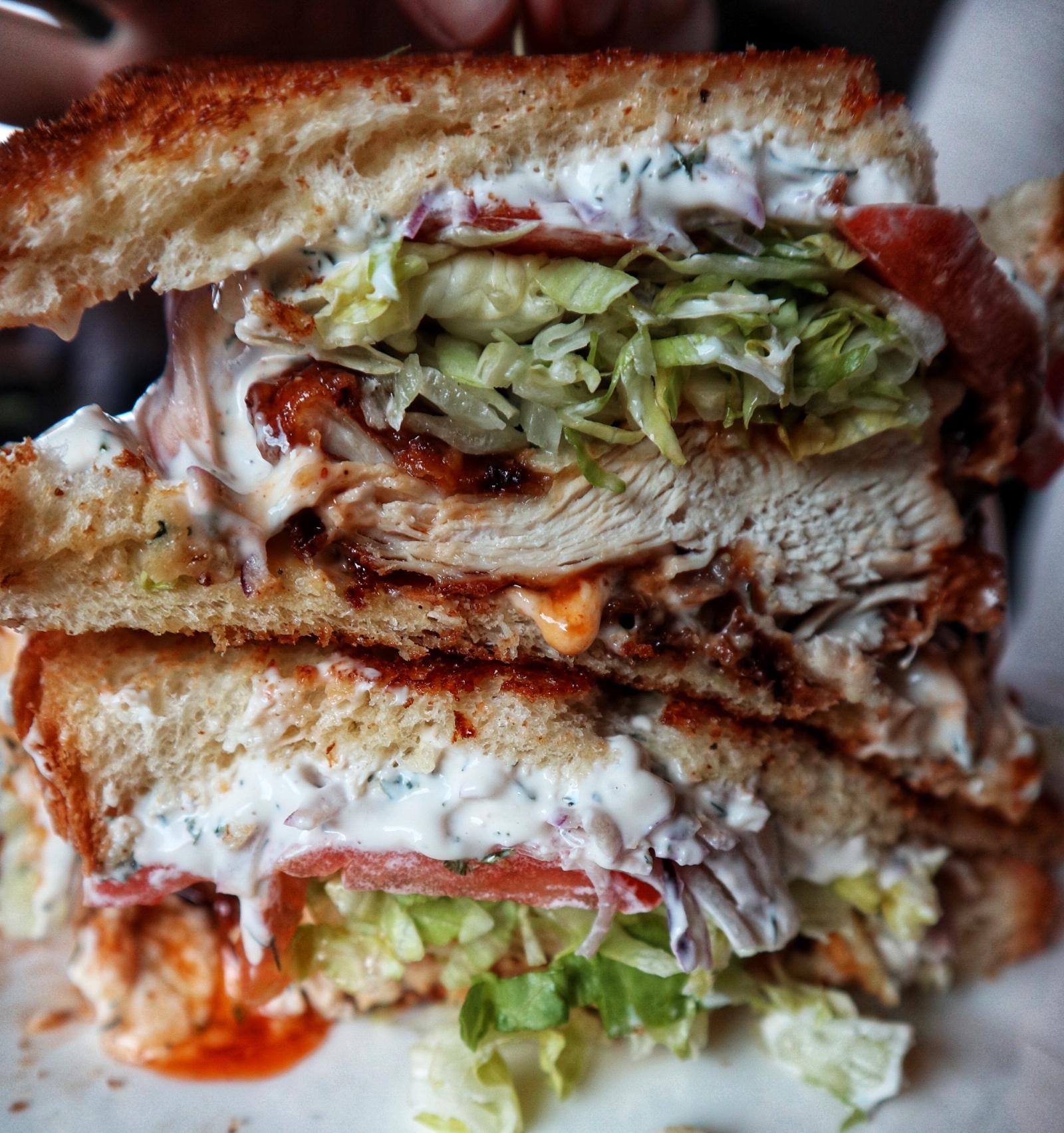 Chicken Sandwich: fried chicken, crystal glaze, LTO, pickles & ranch mayo on lucky cat brioche
