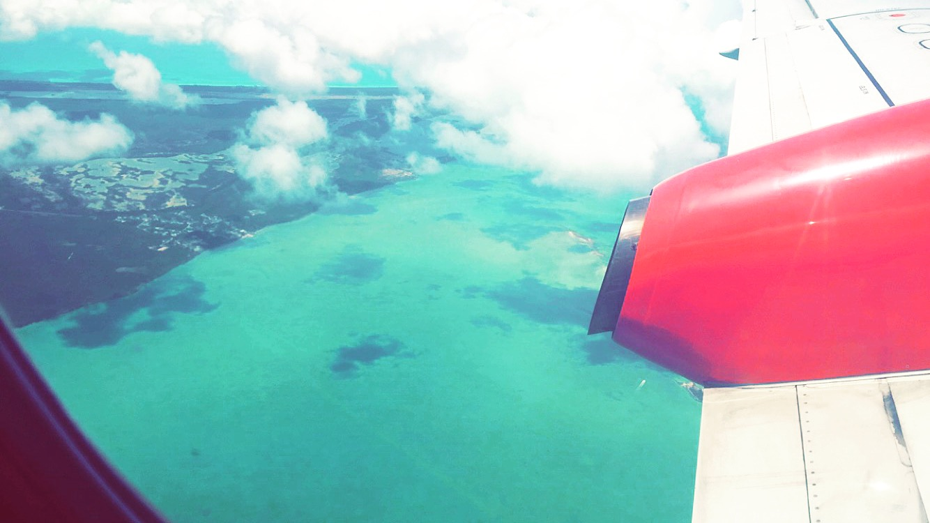travel-blog-blogger-redhead-round-the-world-airplane-window-bahamas.JPG