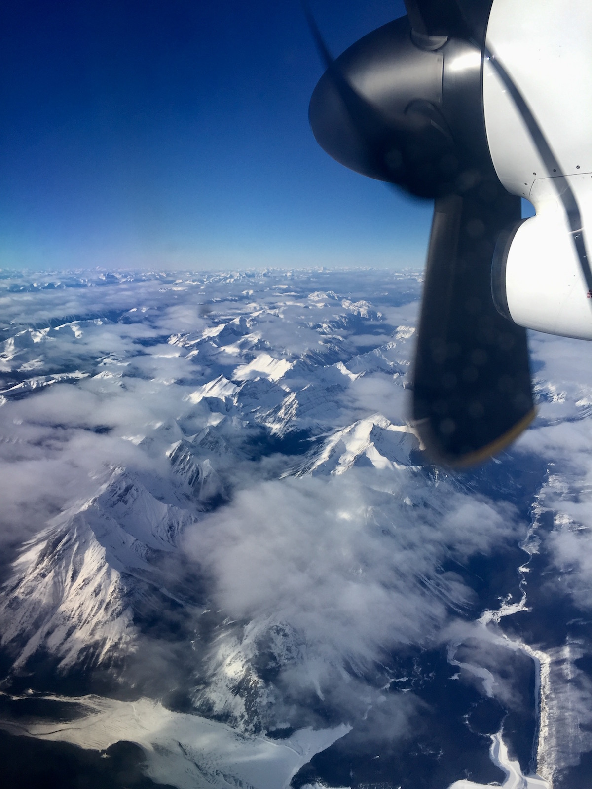 travel-blog-blogger-redhead-round-the-world-airplane-window-moutain.jpg