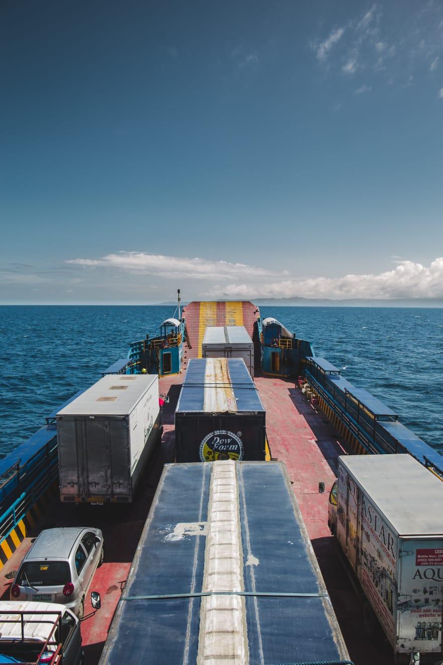 travel-blog-blogger-redhead-round-the-world-philippines-cebu-boat-trucks.jpg