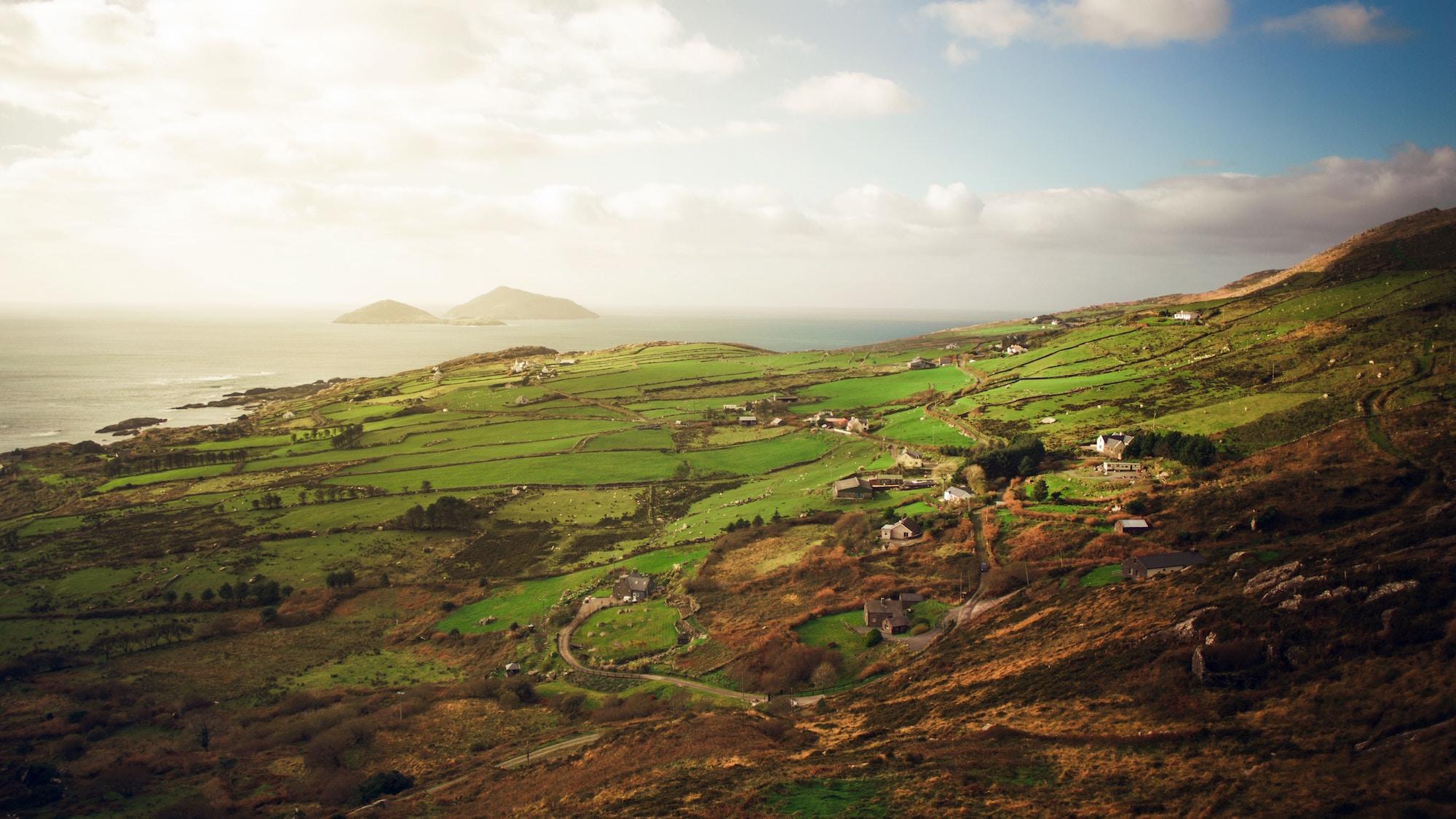 redhead-round-the-world-blogger-ireland-destinations-fields-green-water-light.jpg