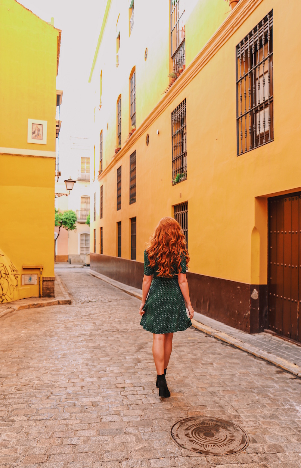 The colourful streets of Santa Cruz - Right around the corner from here is Spain's oldest tapas bar - El Rinconcillio. Click here to read all about our experience there.