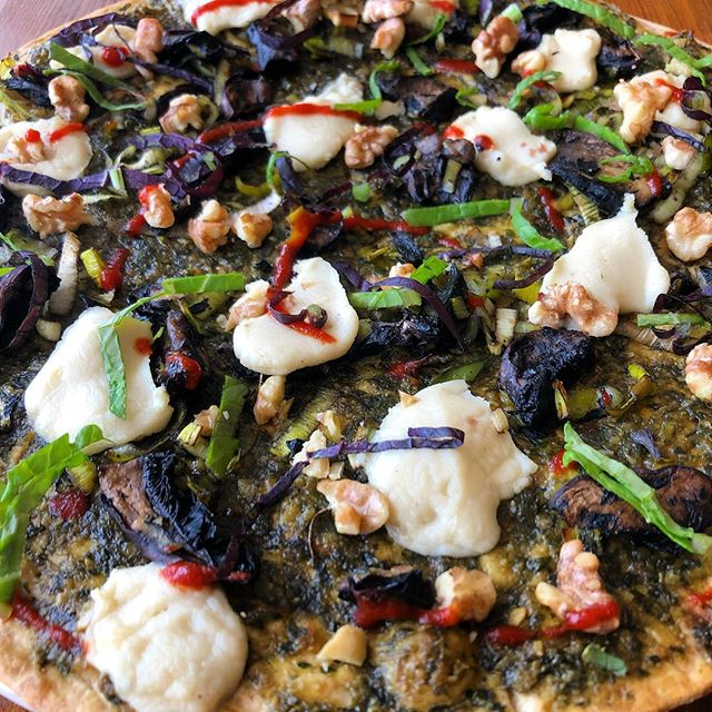 FIRST FRIDAY SPECIAL! Lavash flatbread pizzas with house made vegan cheese, house made pesto, walnut, portabella, and leek sprinkled with mustards and sriracha .... 12$ and we're open until 8pm tonight❤️ #foodmagic #baltimorevegan #madewithlove #vegan #veganbaltimore #knowyourfarmerknowyourfood #marylandvegan @kingmushroom15 @farmalliancebaltimore
