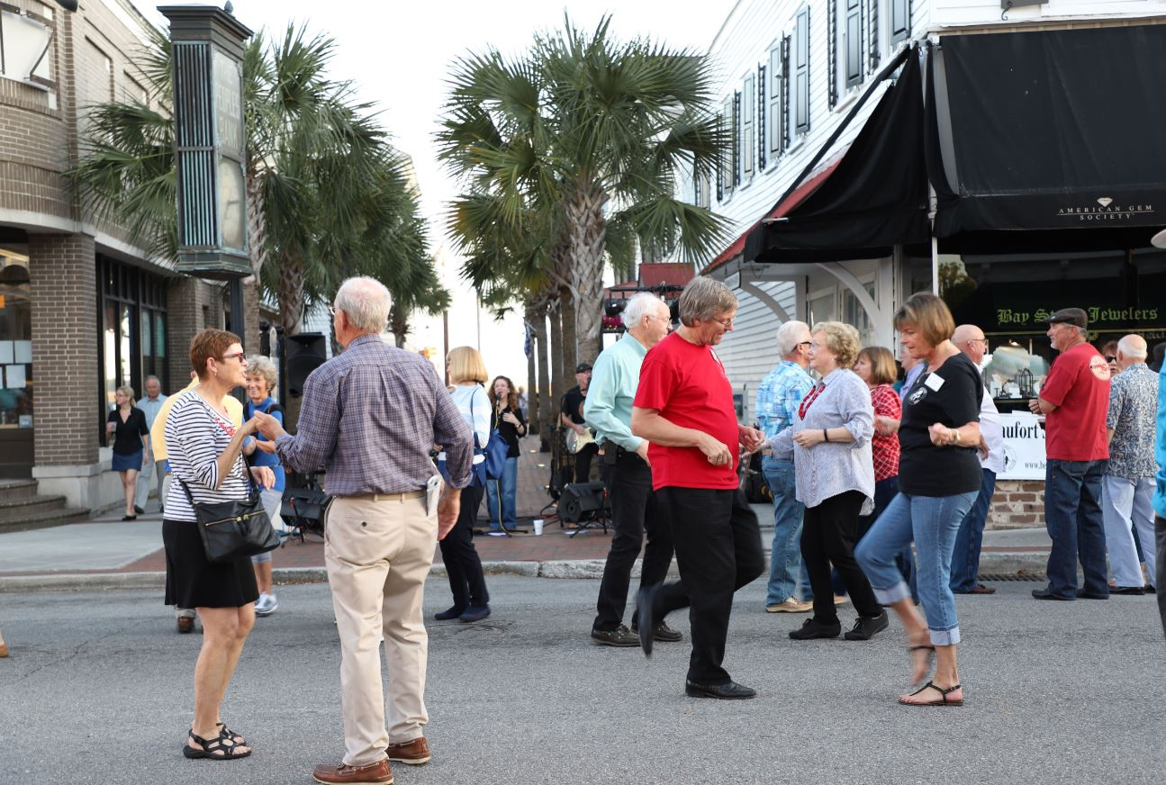 Visitors and locals take the street during First Friday, downtown.