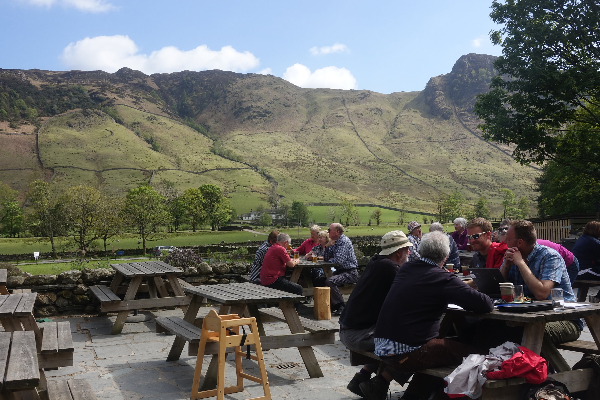 Sitting, enjoying a rest and refreshments at the New Dungeon Ghyll (see  Lake District ). See sheep farmhouse in the river bottom of the dale and walled pastures up hillsides.
