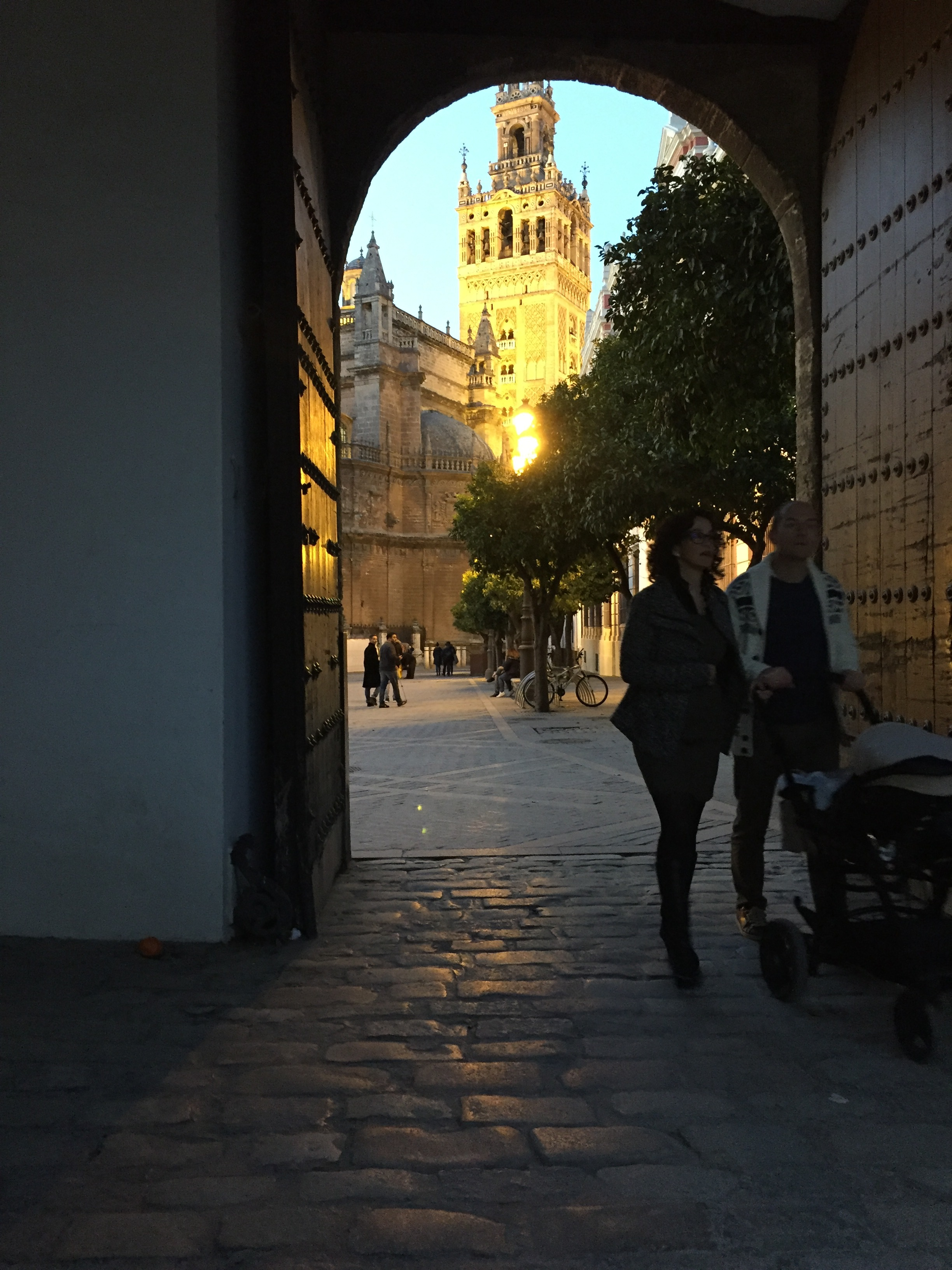 Walking out from the Alcázar and looking at the cathedral of Seville