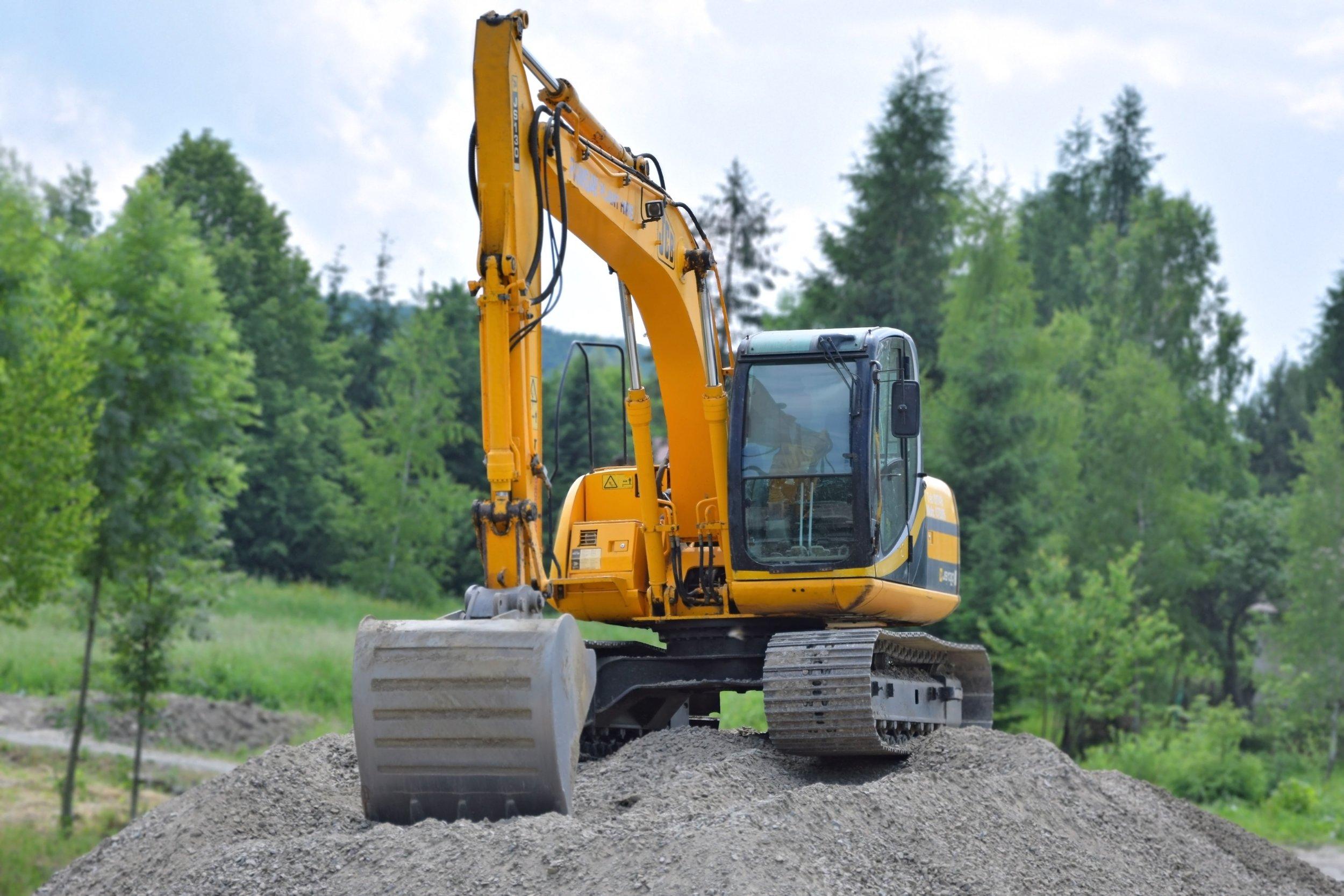 construction-excavator-gravel-95687.jpg