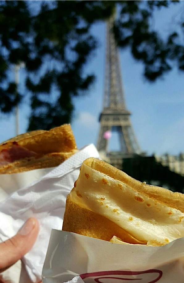 Eating fresh Crepes with of a view of the Eiffel Tower