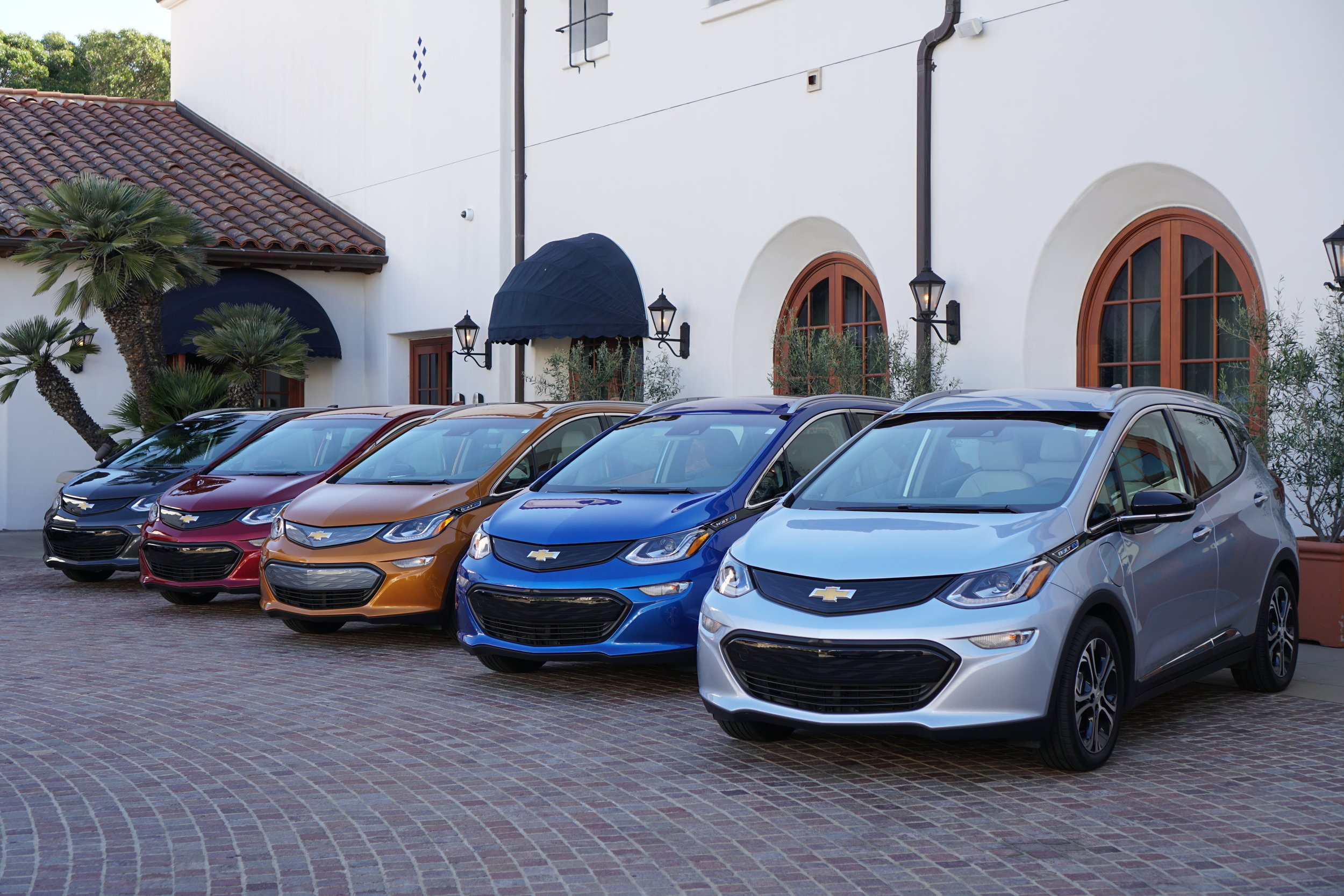 The Chevrolet Bolt EV's in different colors waiting for their drivers at the Bacara Resort & Spa press getaway.