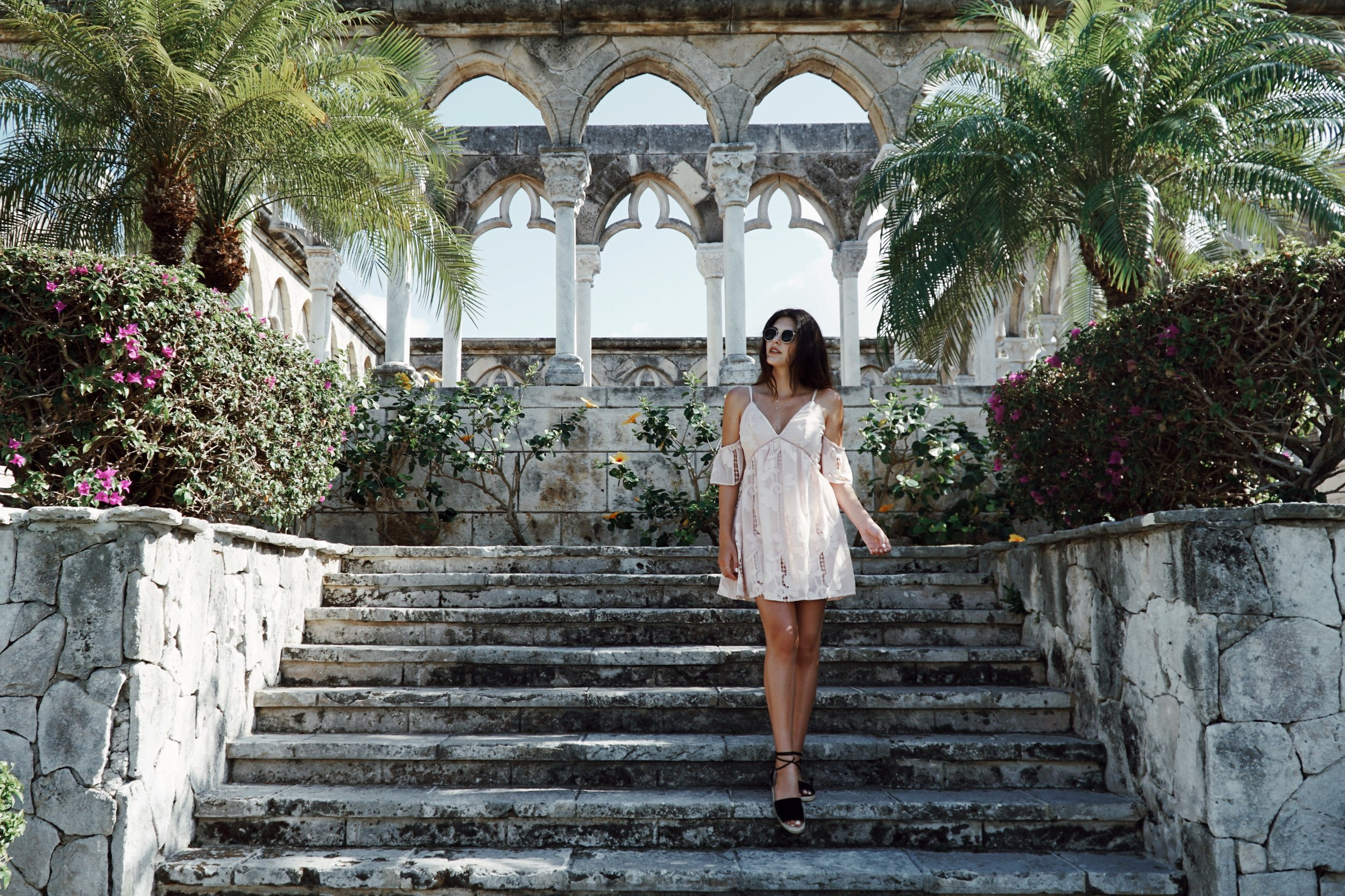 Julia Friedman poses in a Lovers + Friends dress from Revolve Clothing at the Versailles Gardens at the One&Only Ocean Club in Nassau, Bahamas.
