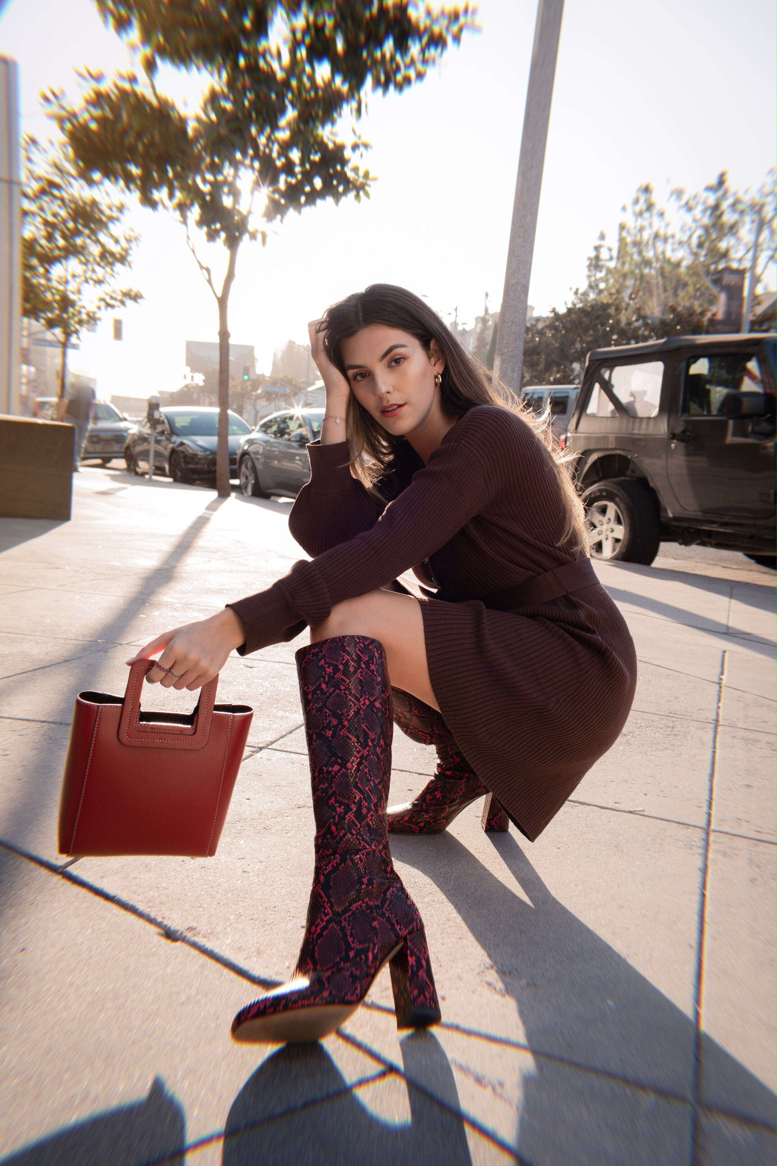 Julia Friedman wearing snakeskin boots in red snakeskin to the knee boots