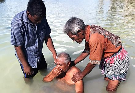 One of the 25 people baptised during a recent visit to Kiribati