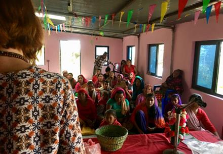 Sister Linda giving her testimony at the outreach in Gorkha