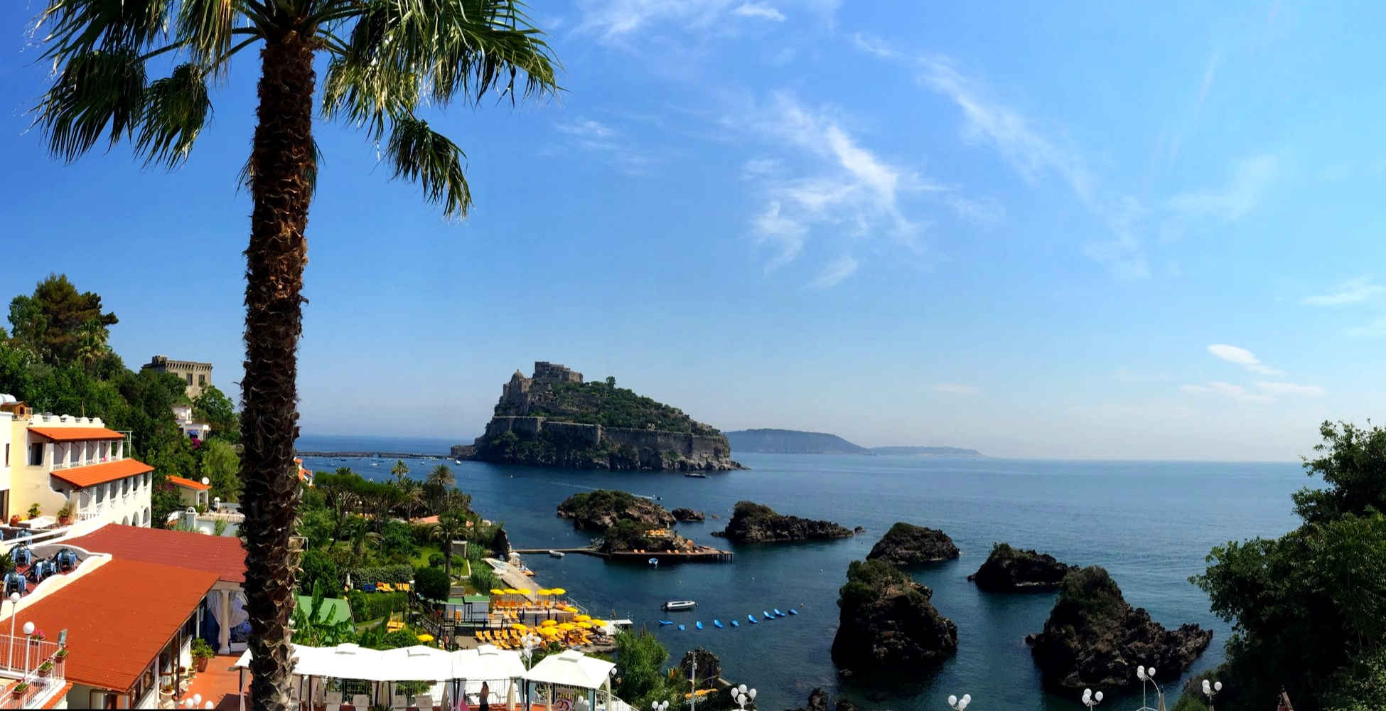 The Aragonese Castle and Procida, from the shores of the Island of Ischia
