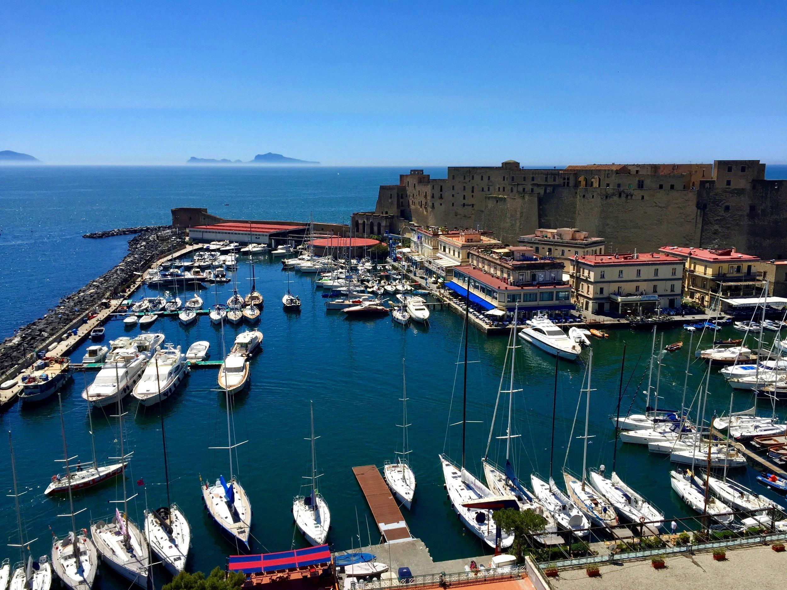 Castel dell'Ovo and Borgo Marinari with view over Capri - Naples