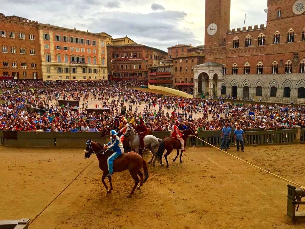 Feel the vibes of Palio di Siena and its many wards - Piazza del Campo