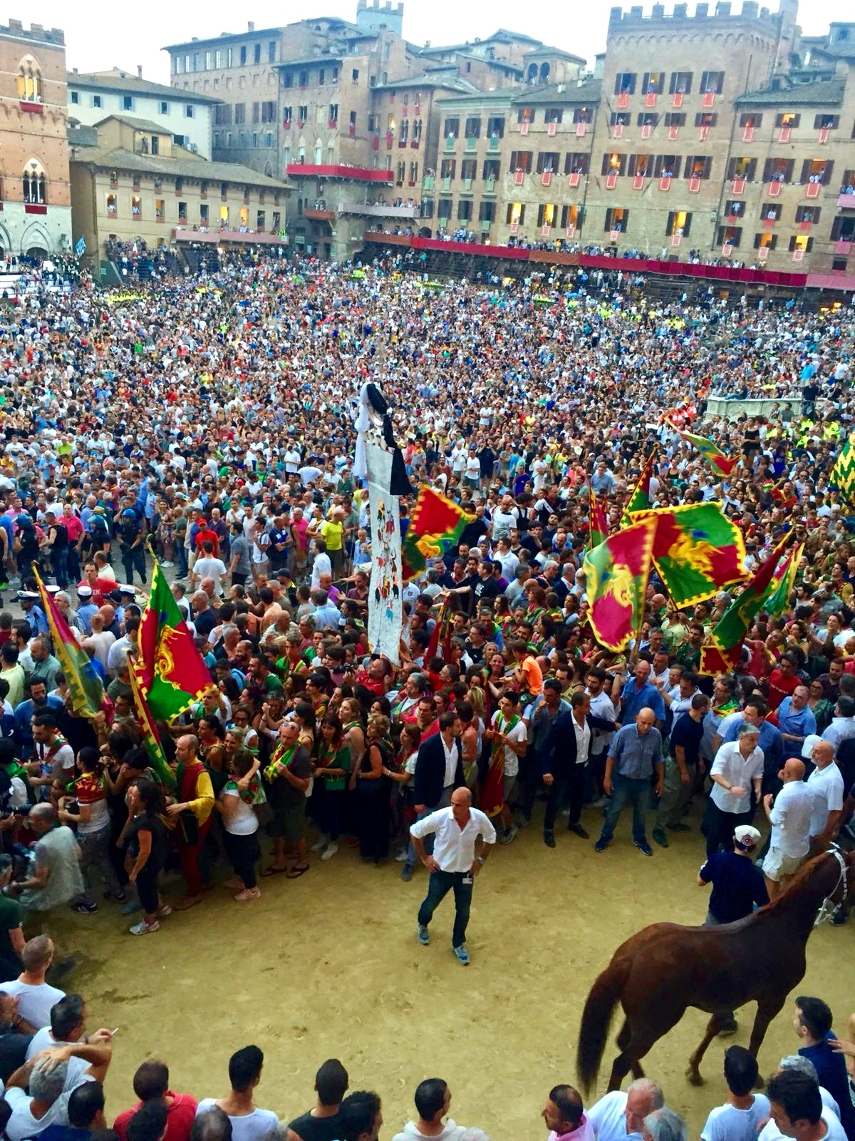 Celebrate the victorious Contrada of Palio horse race - Siena