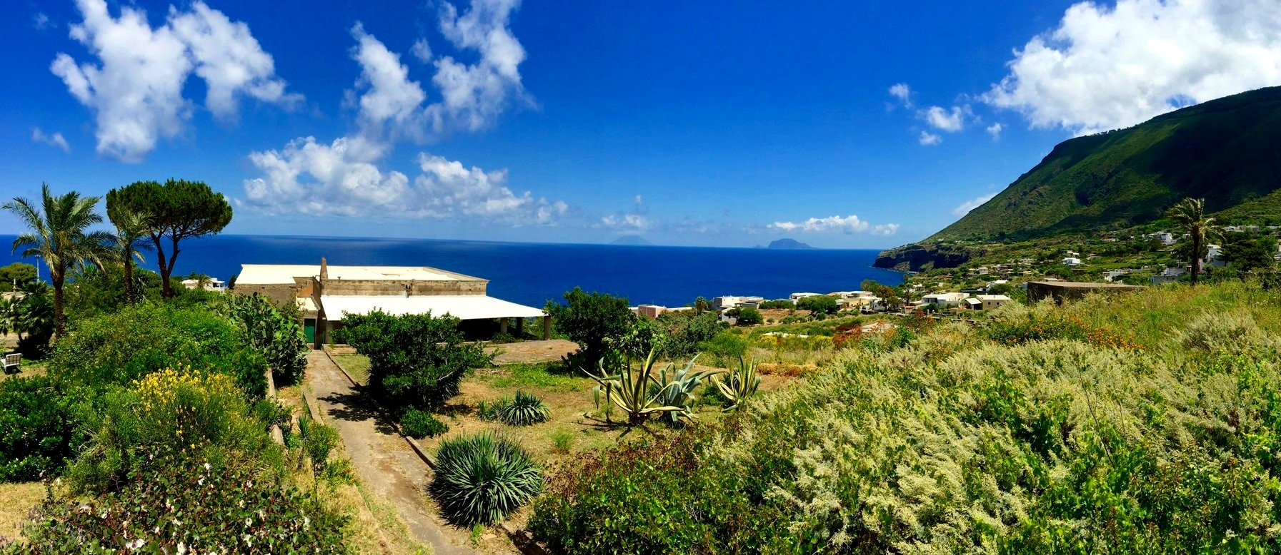 Natural hidden paradises and topnotch hospitality - View of Stromboli and Panarea from Salina, Unesco World Heritage Site of the Aeolian Islands