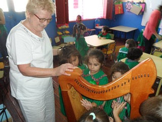 2 March 2015 - To mark the 150th anniversary of 'Y Wladfa' the Welsh settlement in Patagonia, Elinor Bennett delivers one of two harps to the children Ysgol Meithrin Trelew.   Read More