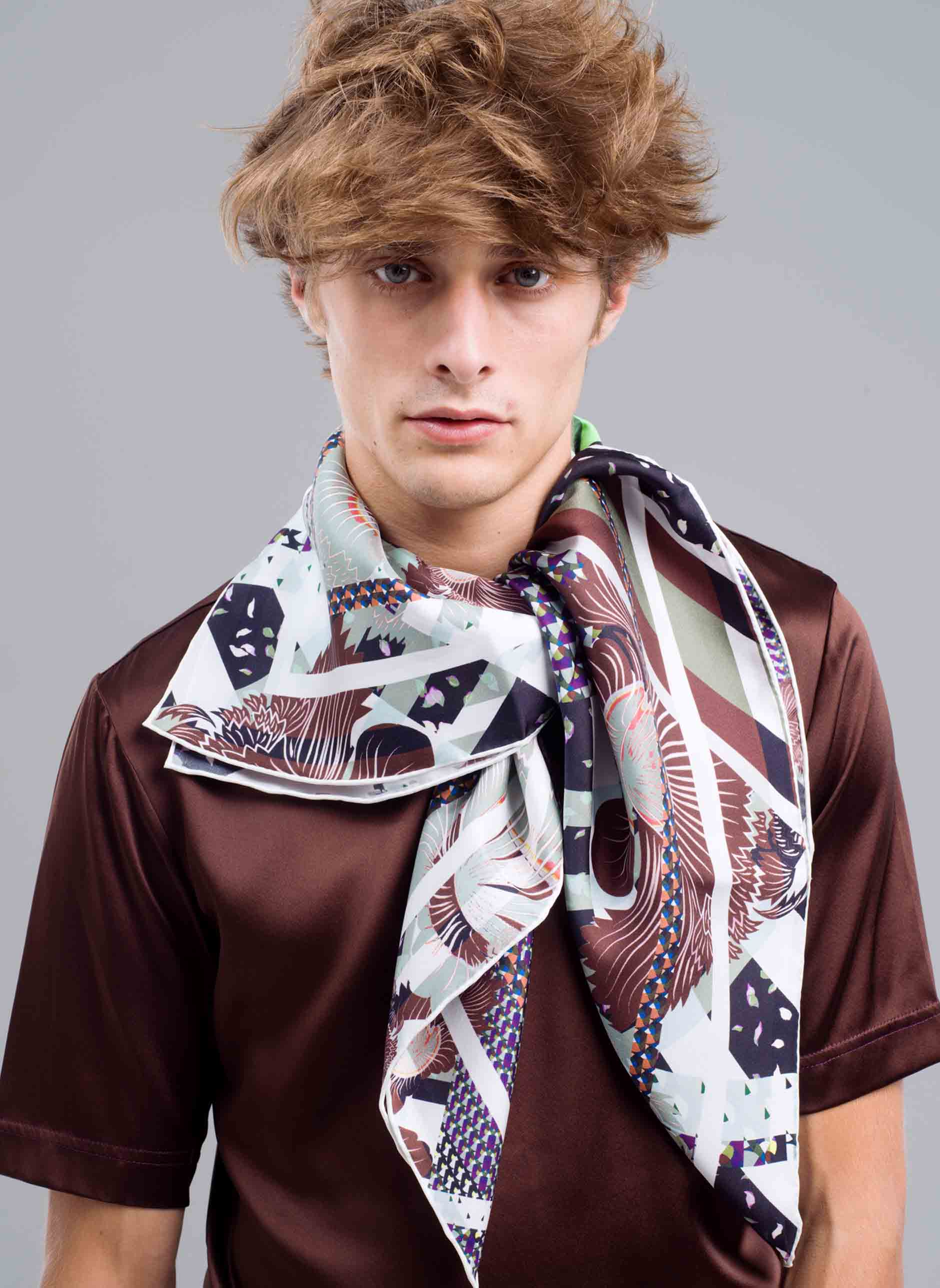 MENG Menswear Silk Scarf With Chocolate and Dark Hued Details on White Background