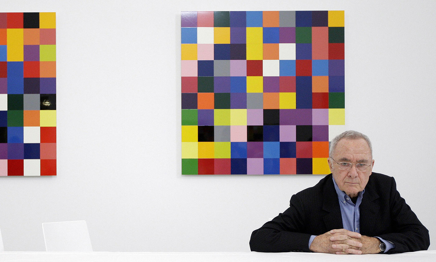 The German artist Gerhard Richter with a panel from his  4900 Colours  (2008) at the Serpentine Gallery in London. The seemingly arbitrary distribution of colours was generated using a specially developed computer program.  Photo by Shaun Curry/Getty