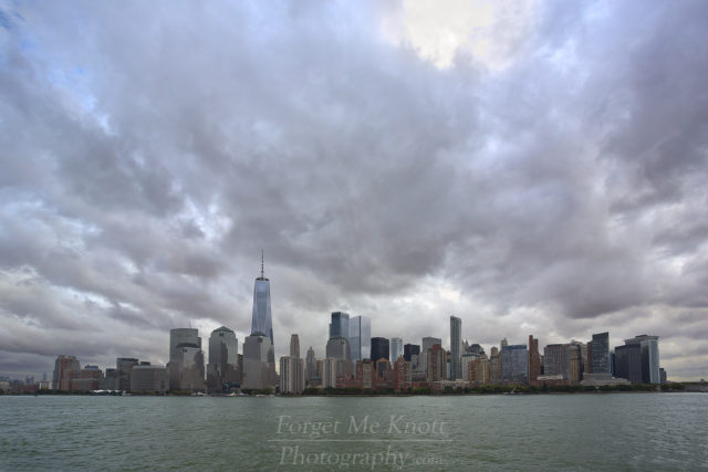 Lower Manhattan, New York city urban skyline freedom tower world trade center hudson river east coast buildings city clouds atlantic ocean