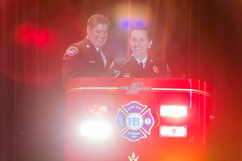 Lopez and Fire Chief David Segura having a little fun with the podium.