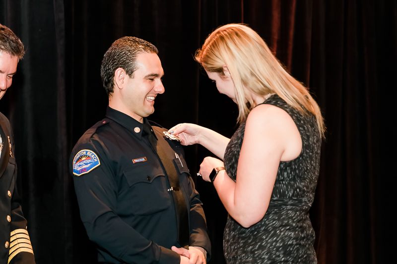 New badges were pinned on by significant others and family members.