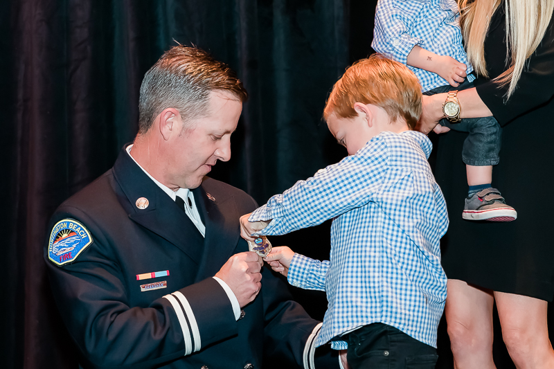 This little guy got the honor of pinning the badge on his dad.