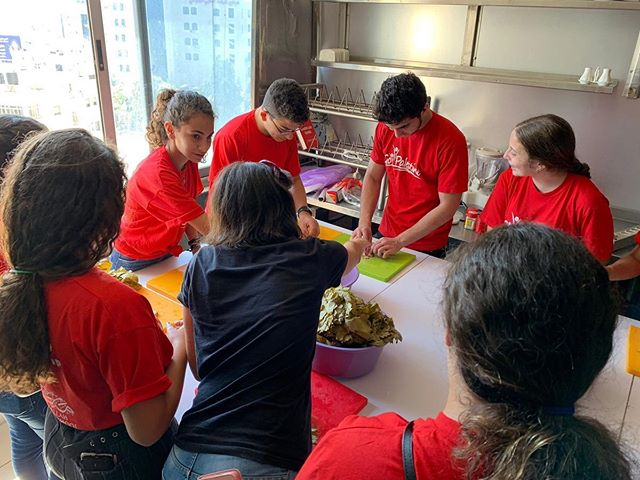 Half our campers learned how to roll grape leaves and core and stuff zucchini!
