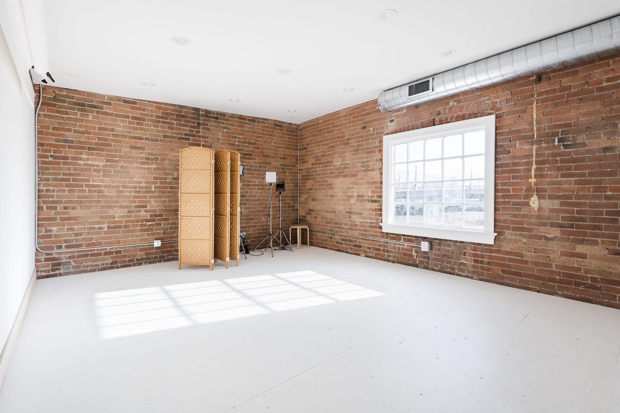 photography studio - the natural light illuminates the exposed brick & white walls of the foundry slc.We offer studio lighting and an assortment of colored paper backdrops to best accommodate your photography needs.