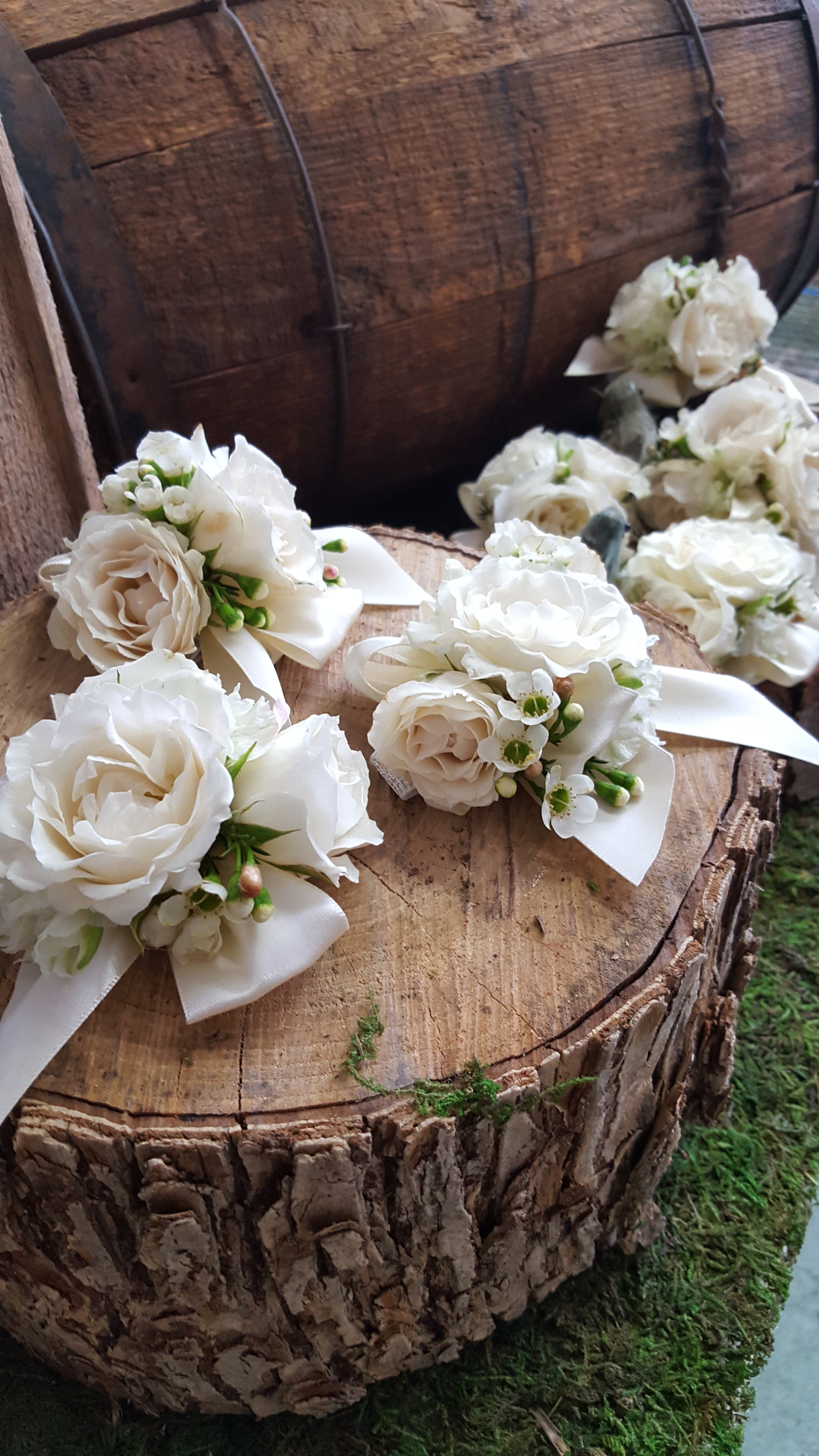 spray rose and waxflower corsages.jpg