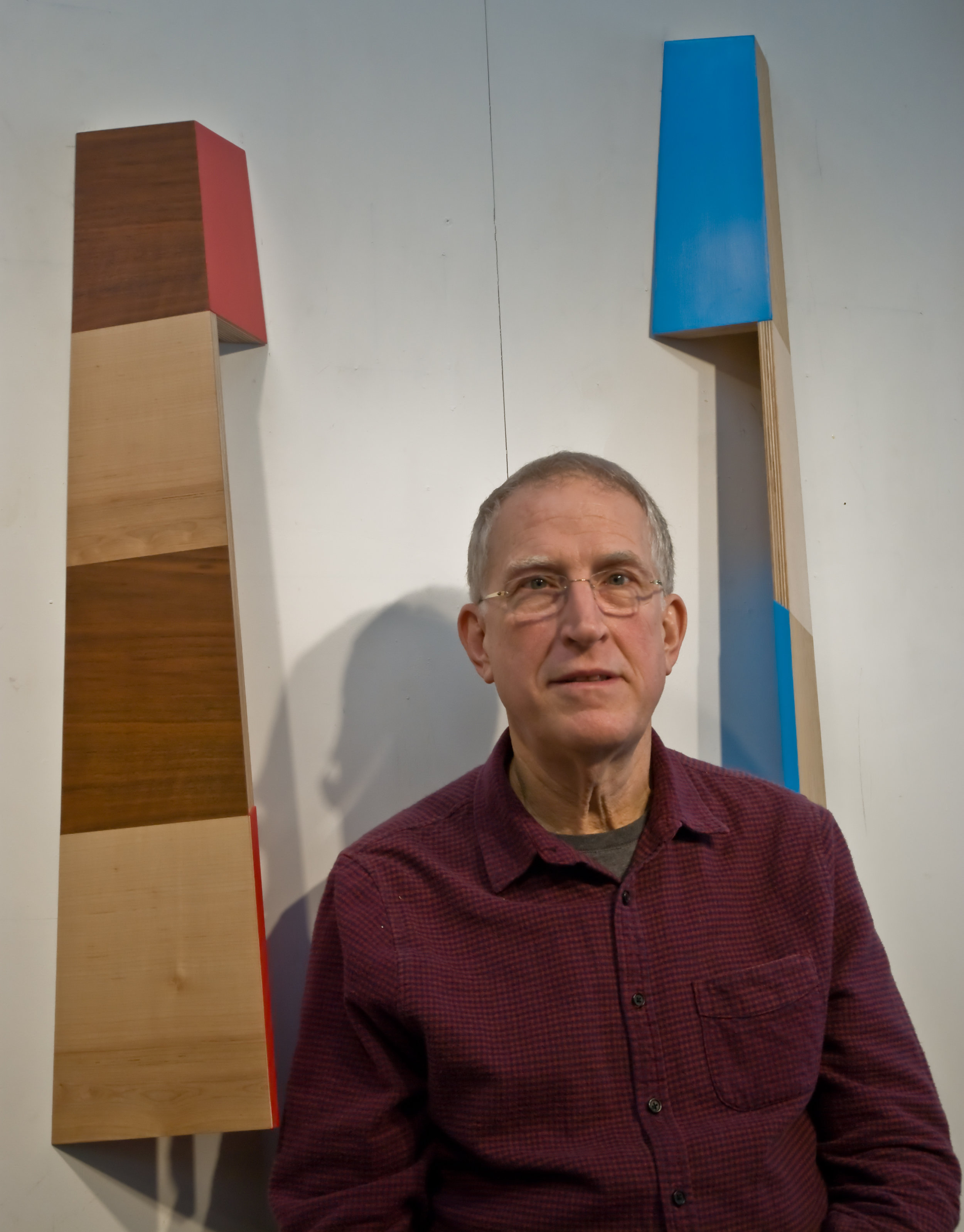 "Richard Bottwin - ""Architecture and functional objects inform the vocabulary of my sculpture. The plywood surfaces, laminated with wood veneers or painted with acrylic colors, are configured to reveal surprising shapes and patterns with shifts in the viewer's perspective. A sense of disorientation, implied weightlessness, human gesture and the element of surprise are created by the reductive forms and subvert the modernist vocabulary of the simple constructions.""RICHARD BOTTWIN (b. 1950) lives and works in New York City and has maintained his sculpture studio in Brooklyn since 1990. He has had solo exhibitions at, among others, OK Harris Gallery in New York, Metaphor Gallery in Brooklyn, and Pentimenti Gallery in Philadelphia. He has participated in group exhibitions at Tacit Gallery, Melbourne; DM Contemporary Gallery, New York; Bunsen/ Götz Galerie, Nuremberg; Galleri Tom Christoffersen, Copenhagen; and Art Forum Ute Barth, Zurich. His work has been included in group shows at The Neuer Kunstverein in Aschaffenburg, Germany; The Visual Arts Center of New Jersey, Summit NJ; Moma PS 1 in Long Island City, NY; and the Pennsylvania Academy of Fine Arts in Philadelphia. Bottwin has also created site-specific installations at The Sculpture Center in Long Island City, NY; The Pratt Institute in Brooklyn NY; and in Fairmont Park, Philadelphia (with the Philadelphia Art Alliance). His work in public collections includes the Bayerische Landesbank headquarters in NYC and The Pratt Institute outdoor sculpture collection in Brooklyn. He has received two artist's grants from the State of Pennsylvania and one from New York State, and he was awarded a residency at the Edward Albee Foundation, Montauk NY. His work has been reviewed in The New York Times, The Philadelphia Inquirer and The Brooklyn Rail."