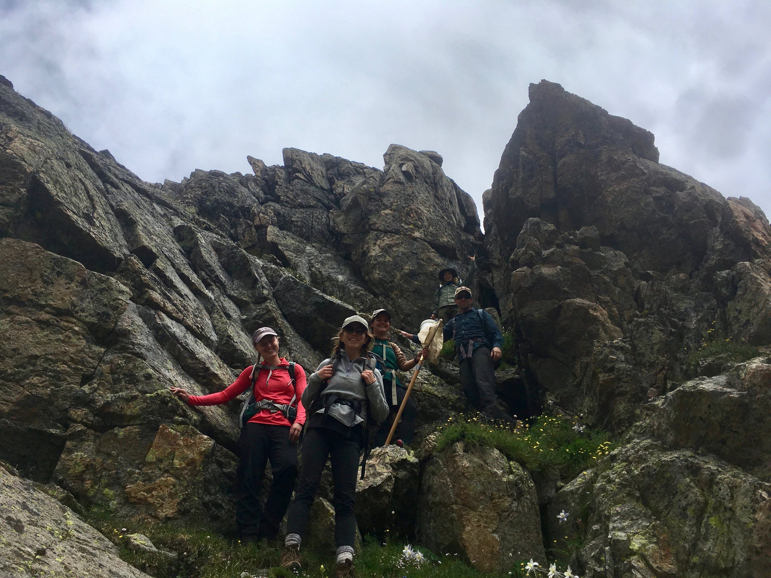 Photo by Kelly Loria of Dr. Johnson with AJ Lodge, UROP students Anika Cobb and Emma Ordemann and REU student Sammy Yevak hiking down from Green Lake 4 (GL4).