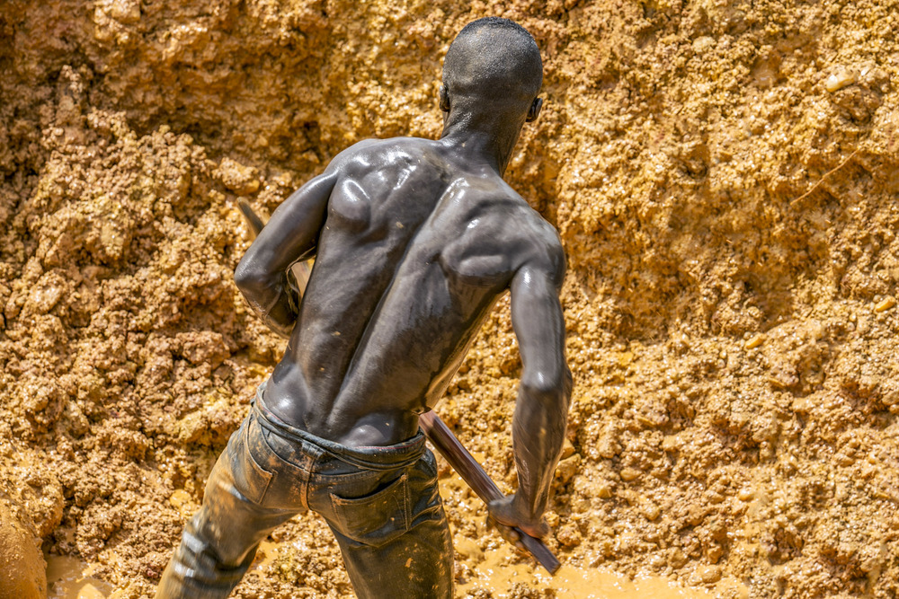 """These mining operations are known locally as """"galamsey."""" In every direction, one can see another galamsey operation. The term literally meaning """"gather them and sell."""" Swarms of workers toil away under the oppressive heat and dangerous conditions. © Heidi Woodman"""