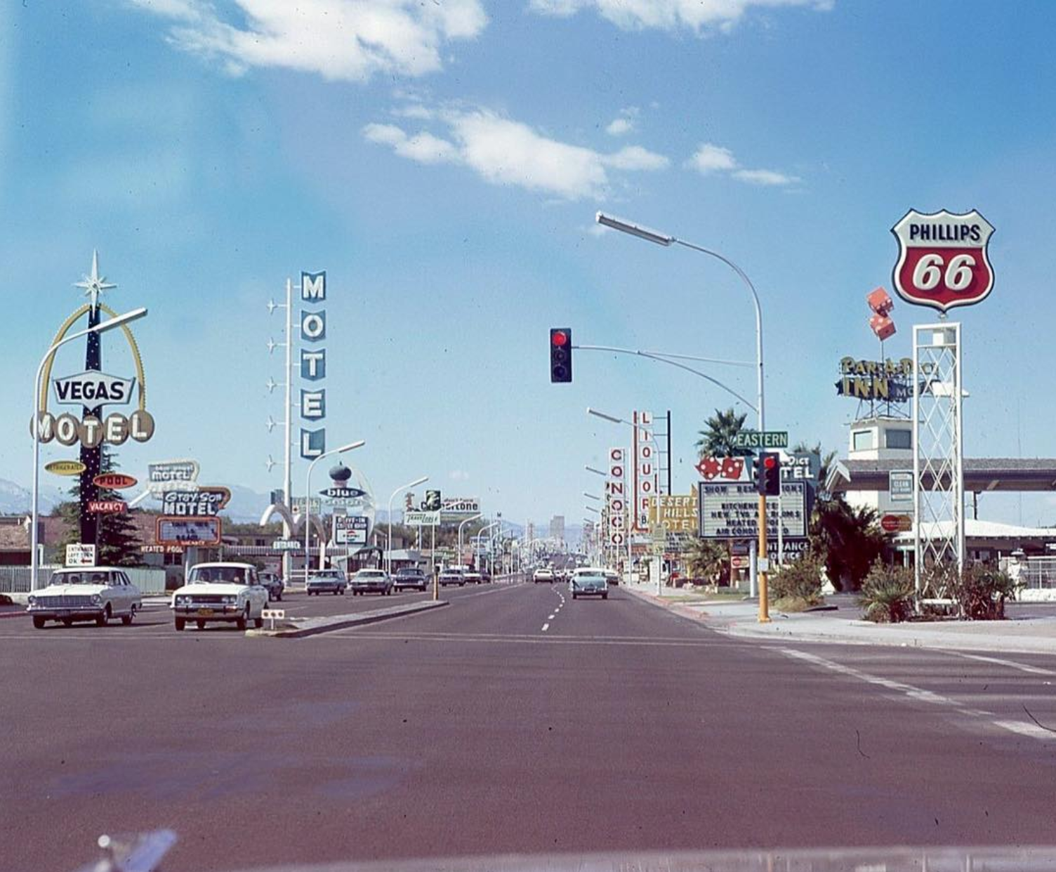 1969. Fremont St at Eastern Ave looking west. Vegas Motel, Blue Angel Motel, and Blue Onion Drive-In on the left. Par-a-Dice Inn and Desert Hills Motel on the right. Desert Hills remains open, and repainted their sign last fall. © Vintage Las Vegas Instagram