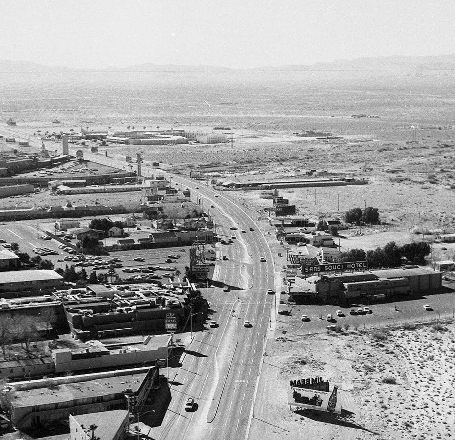 Over the Strip, January 11, 1961. We're looking south over the area where Palazzo, Venetian, The Mirage, and Treasure Island now stand. To the left: Sands, Kit Carson Motel, and Tam O'Shanter Motel which lasted to 2005. On the right: Sans Souci Hotel, service stations, and the private residence of Grace Hayes. © Vintage Las Vegas Instagram