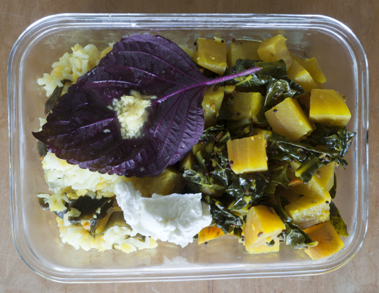 One of the author's ayurvedic bentos with the ginger appetizer on a leaf of shiso