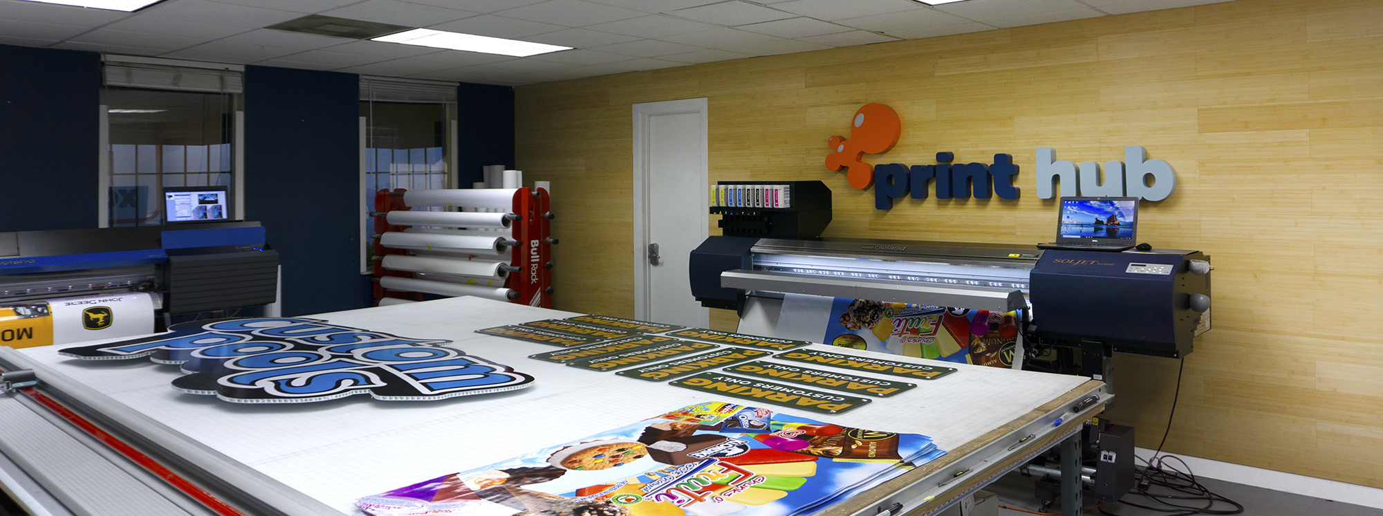 production lab of Print Hub a Miami sign shop printing banners vehicle wraps, and more