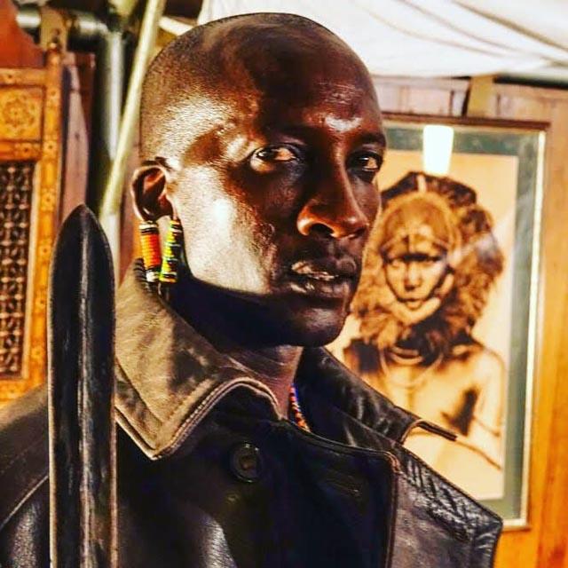 But, no fear: Maasai 'askari' stand guard all night…