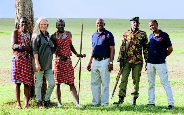 …accompanied by Maasai trackers and an armed park ranger while camp staff go ahead.