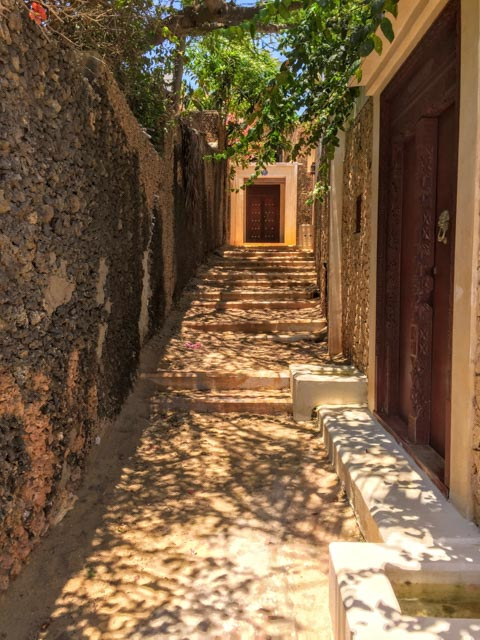 …or foot through shady alleys of coral walls.